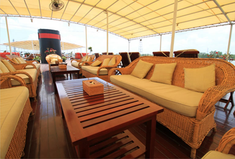 Relax and enjoy the passing sights on our 360-degree promenade decks