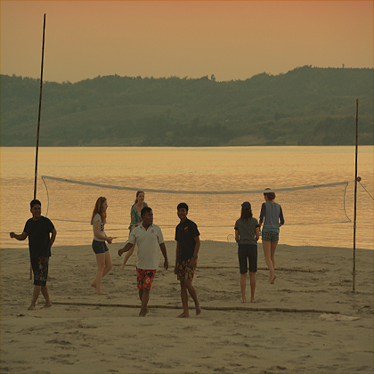 Playing volley ball on the sand banks