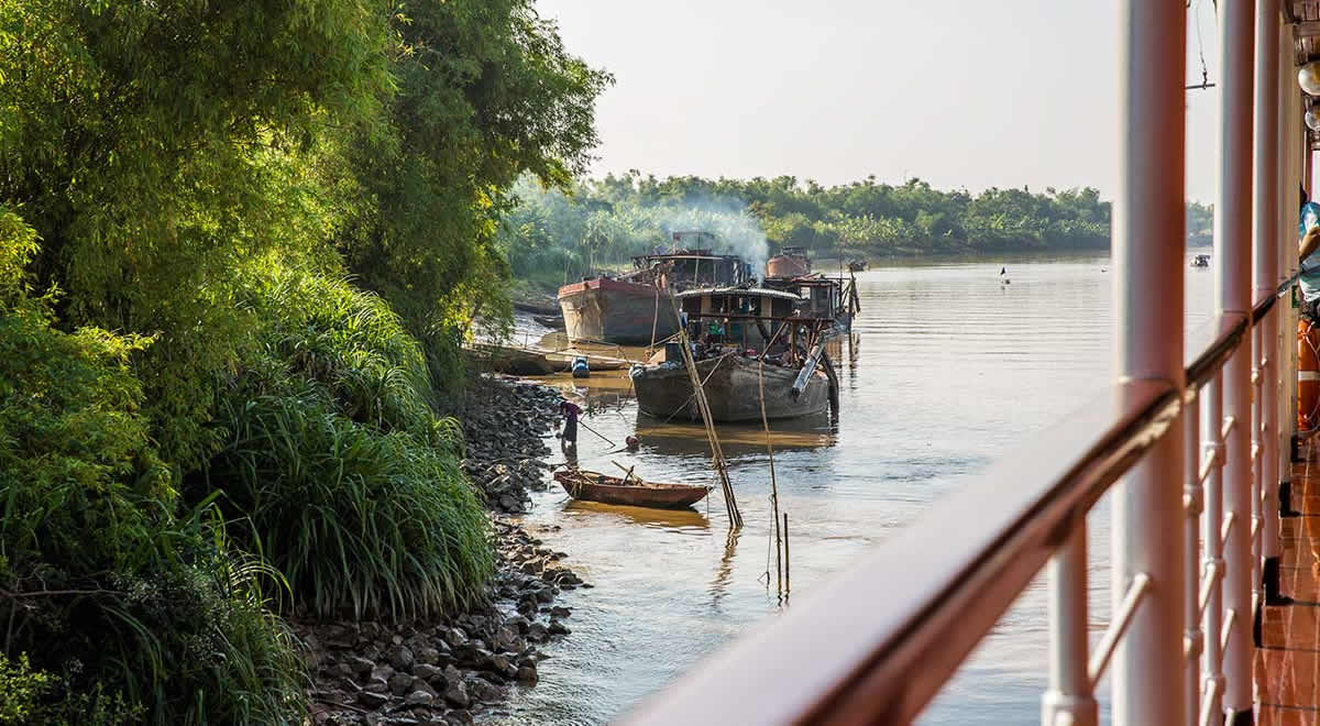 Locals' vessels moored on the banks of the Duong River